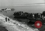 Image of Korean refugees ferrying across river Pyongyang North Korea, 1950, second 19 stock footage video 65675032638