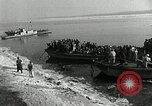 Image of Korean refugees ferrying across river Pyongyang North Korea, 1950, second 20 stock footage video 65675032638