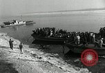 Image of Korean refugees ferrying across river Pyongyang North Korea, 1950, second 21 stock footage video 65675032638