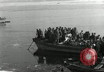 Image of Korean refugees ferrying across river Pyongyang North Korea, 1950, second 31 stock footage video 65675032638
