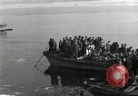 Image of Korean refugees ferrying across river Pyongyang North Korea, 1950, second 32 stock footage video 65675032638