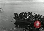 Image of Korean refugees ferrying across river Pyongyang North Korea, 1950, second 33 stock footage video 65675032638