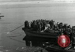 Image of Korean refugees ferrying across river Pyongyang North Korea, 1950, second 35 stock footage video 65675032638