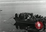 Image of Korean refugees ferrying across river Pyongyang North Korea, 1950, second 36 stock footage video 65675032638