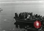 Image of Korean refugees ferrying across river Pyongyang North Korea, 1950, second 37 stock footage video 65675032638