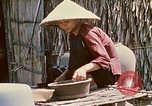 Image of villagers Vietnam, 1970, second 46 stock footage video 65675032671