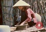 Image of villagers Vietnam, 1970, second 47 stock footage video 65675032671