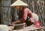Image of villagers Vietnam, 1970, second 51 stock footage video 65675032671