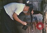Image of villagers Vietnam, 1970, second 57 stock footage video 65675032672
