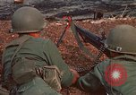 Image of RF-PF forces with M-60 machine gun and M-79 Grenade Launcher Vietnam, 1970, second 15 stock footage video 65675032682