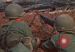 Image of RF-PF forces with M-60 machine gun and M-79 Grenade Launcher Vietnam, 1970, second 16 stock footage video 65675032682