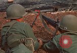 Image of RF-PF forces with M-60 machine gun and M-79 Grenade Launcher Vietnam, 1970, second 17 stock footage video 65675032682