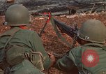 Image of RF-PF forces with M-60 machine gun and M-79 Grenade Launcher Vietnam, 1970, second 18 stock footage video 65675032682