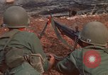 Image of RF-PF forces with M-60 machine gun and M-79 Grenade Launcher Vietnam, 1970, second 19 stock footage video 65675032682