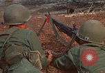 Image of RF-PF forces with M-60 machine gun and M-79 Grenade Launcher Vietnam, 1970, second 20 stock footage video 65675032682