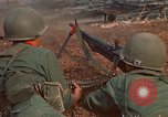 Image of RF-PF forces with M-60 machine gun and M-79 Grenade Launcher Vietnam, 1970, second 21 stock footage video 65675032682
