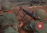 Image of RF-PF forces with M-60 machine gun and M-79 Grenade Launcher Vietnam, 1970, second 22 stock footage video 65675032682