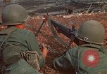 Image of RF-PF forces with M-60 machine gun and M-79 Grenade Launcher Vietnam, 1970, second 23 stock footage video 65675032682