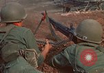 Image of RF-PF forces with M-60 machine gun and M-79 Grenade Launcher Vietnam, 1970, second 24 stock footage video 65675032682