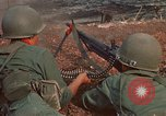 Image of RF-PF forces with M-60 machine gun and M-79 Grenade Launcher Vietnam, 1970, second 25 stock footage video 65675032682
