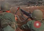 Image of RF-PF forces with M-60 machine gun and M-79 Grenade Launcher Vietnam, 1970, second 26 stock footage video 65675032682