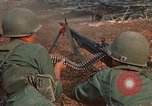 Image of RF-PF forces with M-60 machine gun and M-79 Grenade Launcher Vietnam, 1970, second 27 stock footage video 65675032682