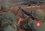 Image of RF-PF forces with M-60 machine gun and M-79 Grenade Launcher Vietnam, 1970, second 28 stock footage video 65675032682