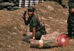 Image of Vietnamese Forces engaged in live fire mock combat Vietnam, 1970, second 60 stock footage video 65675032684
