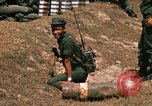 Image of Vietnamese Forces engaged in live fire mock combat Vietnam, 1970, second 61 stock footage video 65675032684