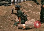 Image of Vietnamese Forces engaged in live fire mock combat Vietnam, 1970, second 62 stock footage video 65675032684