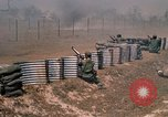 Image of Vietnamese forces firing M-16s in live fire exercise Vietnam, 1970, second 51 stock footage video 65675032685