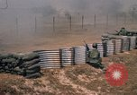 Image of Vietnamese forces firing M-16s in live fire exercise Vietnam, 1970, second 53 stock footage video 65675032685