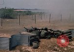 Image of Vietnamese forces firing M-16s in live fire exercise Vietnam, 1970, second 55 stock footage video 65675032685