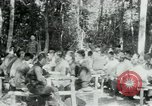Image of Viet Cong political meeting at base in jungle Vietnam, 1965, second 3 stock footage video 65675032693