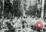 Image of Viet Cong political meeting at base in jungle Vietnam, 1965, second 5 stock footage video 65675032693