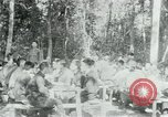 Image of Viet Cong political meeting at base in jungle Vietnam, 1965, second 6 stock footage video 65675032693