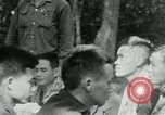 Image of Viet Cong political meeting at base in jungle Vietnam, 1965, second 11 stock footage video 65675032693
