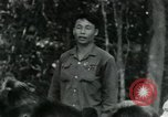 Image of Viet Cong political meeting at base in jungle Vietnam, 1965, second 13 stock footage video 65675032693
