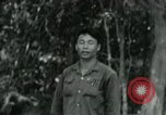Image of Viet Cong political meeting at base in jungle Vietnam, 1965, second 14 stock footage video 65675032693