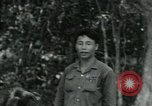Image of Viet Cong political meeting at base in jungle Vietnam, 1965, second 15 stock footage video 65675032693