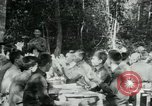 Image of Viet Cong political meeting at base in jungle Vietnam, 1965, second 16 stock footage video 65675032693