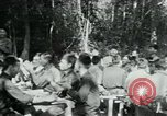 Image of Viet Cong political meeting at base in jungle Vietnam, 1965, second 17 stock footage video 65675032693
