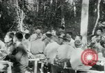 Image of Viet Cong political meeting at base in jungle Vietnam, 1965, second 18 stock footage video 65675032693