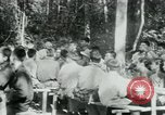 Image of Viet Cong political meeting at base in jungle Vietnam, 1965, second 19 stock footage video 65675032693
