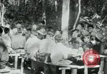 Image of Viet Cong political meeting at base in jungle Vietnam, 1965, second 20 stock footage video 65675032693