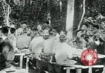 Image of Viet Cong political meeting at base in jungle Vietnam, 1965, second 21 stock footage video 65675032693