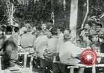 Image of Viet Cong political meeting at base in jungle Vietnam, 1965, second 22 stock footage video 65675032693