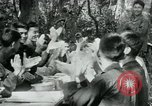 Image of Viet Cong political meeting at base in jungle Vietnam, 1965, second 23 stock footage video 65675032693