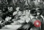 Image of Viet Cong political meeting at base in jungle Vietnam, 1965, second 24 stock footage video 65675032693