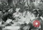 Image of Viet Cong political meeting at base in jungle Vietnam, 1965, second 25 stock footage video 65675032693